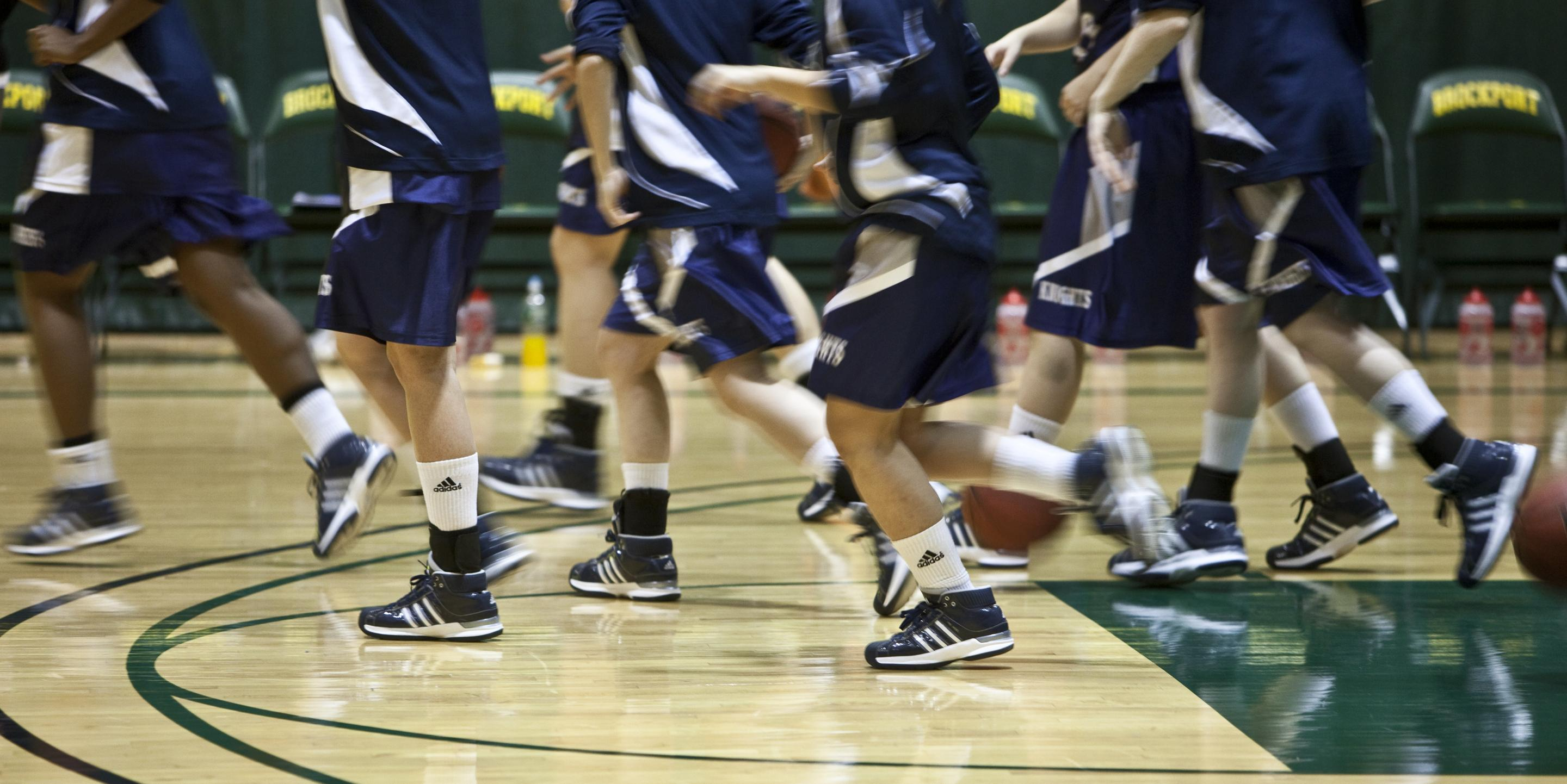 A photo of basketball players running.